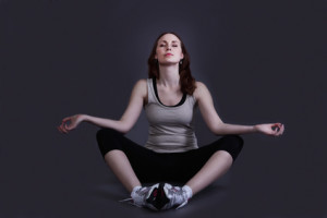 Young woman meditating with eyes closed