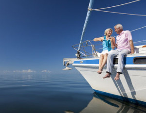Happy Senior Couple on the Bow of a Sail Boat